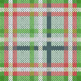 Seamless knitted pattern in various light colors. Seamless vector pattern as a woollen Celtic tartan plaid or a knitted fabric mainly in light red and green hues Royalty Free Stock Images