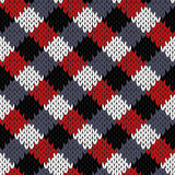 Seamless knitted quadratic pattern. Knitted seamless vector pattern in black, white, grey and red colors with quadratic elements as a fabric texture Stock Images
