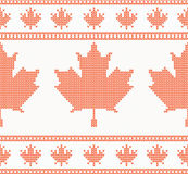 Seamless knitted texture with maple leaf Stock Image
