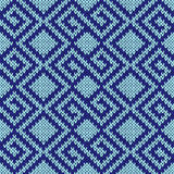 Seamless knitting geometrical pattern in blue hues. Seamless knitting geometrical vector pattern in blue hues as a knitted fabric texture Royalty Free Stock Photo