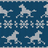 Seamless knitting pattern with horses. And snowflakes Royalty Free Stock Images