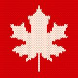 Maple leaf on red - Seamless knitting pattern Stock Images