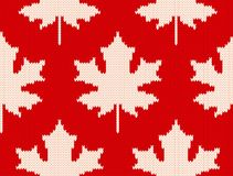 Maple leaves on red - Seamless knitting pattern Stock Image