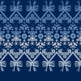 Seamless lace ribbon trim pattern with bow on blue background Royalty Free Stock Photo