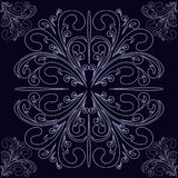 Seamless lacy Ornament on a dark blue Background. Stock Photo