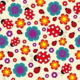 Seamless ladybug background. The image with ladybugs, flowers and hearts Royalty Free Stock Photo