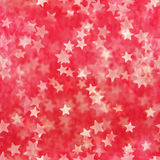 Seamless layered star glitter. Seamless, layered, white stars flying over a red, soft background, from photographed star shapes glitter, in depth of field Stock Photography