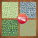 Seamless leaf pattern set. Seamless summer tiny floral patterns on wood background. Stock Photos