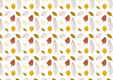 Seamless leaves background in autumn colors. A hand drawn leaves seamless background in autumn color theme Royalty Free Stock Image
