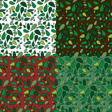 Seamless Leaves Patterns. Set of four seamless leafy backgrounds for stationery or wrapping paper. EPS version contains swatches for each pattern Royalty Free Stock Photos