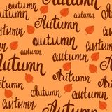 Seamless lettering autumn pattern with leaves stock photography