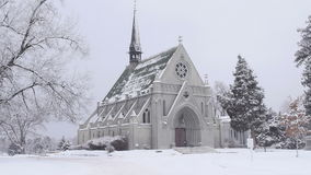 Seamless Loop Chapel in Snowstorm Stock Image