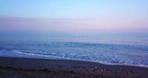 Seamless loop footage of an ocean wave. At sunset 4k stock video footage
