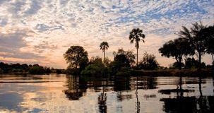 Seamless loop, landscape of the Zambezi river at sunset in Zambia Africa, african nature travel and tourism concept. Video 4K stock footage