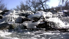 (Seamless Loop) Mountain Snowmelt Overflowing. The mountain snowmelt overflows the banks of the creek stock video