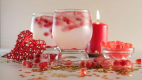 Seamless loop of romantic still life. Saint valentine`s day celebration. Two glasses with alcoholic cocktail and ice. Seamless loop of romantic still life. Two stock video