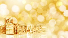 Seamless loop - small Christmas gifts in golden paper, bokeh lights background, HD video. Seamless loop - small Christmas gifts in shiny golden paper, bokeh stock video footage