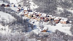 Seamless loop - Snow falling on the village of Saint Martin de Belleville, the Alps, France, video HD stock video footage