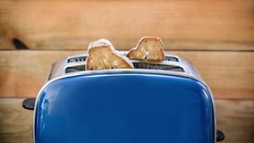 Seamless loop Toast popping out of vintage blue toaster, wooden background, HD videoSeamless loop - Toast popping out of vintage stock footage