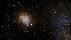 Seamless loop traveling through star fields in space Spiral Galaxy M74.