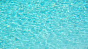 Seamless loop, turquoise blue ripped swimming pool water background, summer concept. Video HD stock video footage