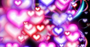 Seamless loop - Valentines Day Hearts and Circles Large R to L Loop. Valentines Day hearts and glowing circles seamless loop - Animated screensaver with pink stock video footage