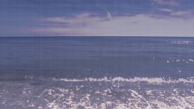 Seamless looped pale blue sea background footage video.