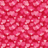 Seamless love hearts background in pink and red. Seamless background pattern with love hearts design in pink and red for Valentine's Day, wedding, scrapbook Stock Image