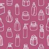 Seamless mönstra av doft buteljerar och skönhetsmedlet Royaltyfria Foton