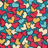 Seamless mönstra av röda hjärtor. Arkivfoto