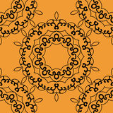 Seamless mandala in outlines on orange background Stock Images
