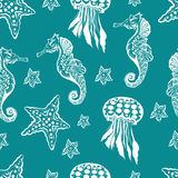 Seamless Marine theme black background. Endless pattern with seahorse, jellyfish and starfish Stock Images