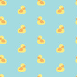 Seamless minimal vector pattern with bright yellow ducks Royalty Free Stock Image