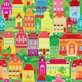 Seamless mönstra med dekorativa färgrika hus Arkivbild