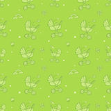 Seamless monochrome green pattern with cute baby carriages. Royalty Free Stock Photo