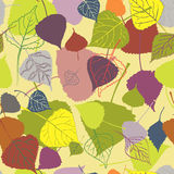 Seamless multi-colored autumn leaves on a yellow background Royalty Free Stock Photos