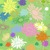 Seamless multi-colored flowers on a green background Stock Photography
