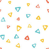 Seamless multicolored baby vector free hand doodle texture with triangles, dry brush ink art. Royalty Free Stock Images