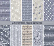 10 seamless music patterns. Set of 10 seamless music patterns. Prints with staff and various musical symbols. Blue-grey, yellowish grey, white colors. Vector Royalty Free Illustration