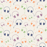 Seamless music vector pattern, chaotic background with colorful headphones Stock Photos