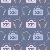 Seamless music vector pattern, symmetrical background with colorful music player, headphones and notes, over blue backdrop Stock Images