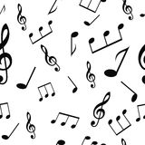 Seamless musical pattern with notes and treble clef Stock Photo
