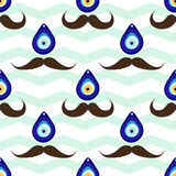 Seamless mustache pattern with evil eye bead Stock Image
