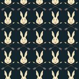 Seamless Native American pattern with hares and arrows royalty free illustration