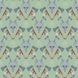 Seamless Native American pattern with wolves and axes Royalty Free Stock Photos