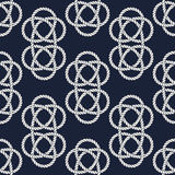 Seamless nautical rope pattern. Carrick Bend knot Royalty Free Stock Images