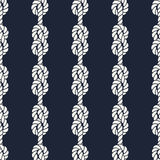 Seamless nautical rope pattern - Figure 8 knots. Seamless nautical rope pattern. Endless navy illustration with white loop ornament. Marine figure eight knots on Stock Photography