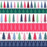 Seamless New Year pattern of bright fir trees and snowflakes. Vector Royalty Free Stock Photo