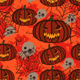 Seamless orange background with pumpkins for Halloween. Stock Photos