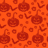 Seamless orange background with pumpkins for Halloween. Stock Photography